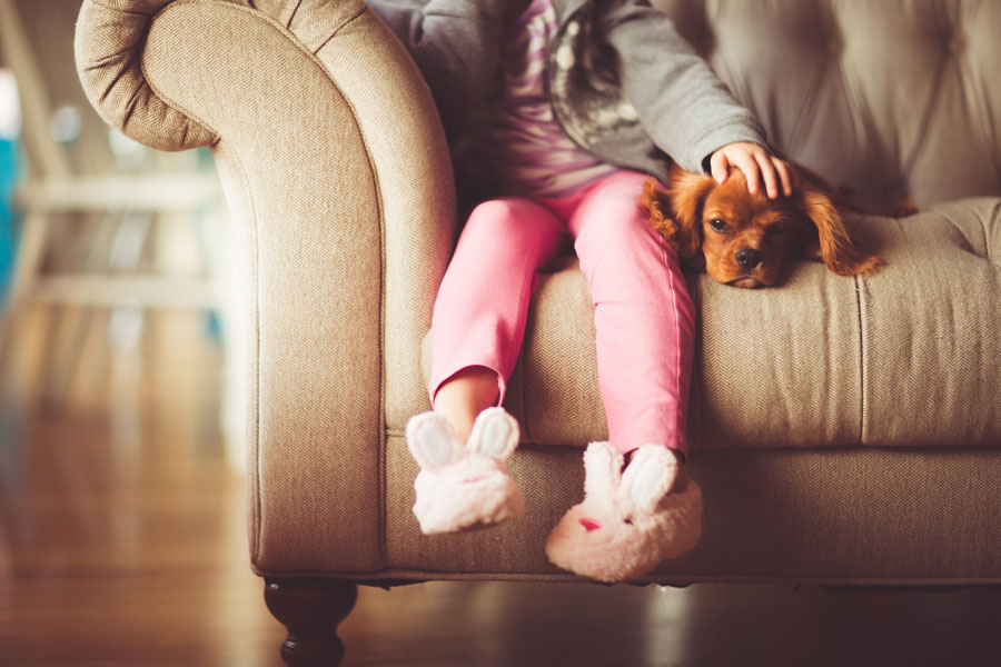 Approved Mortgages Child on Sofa
